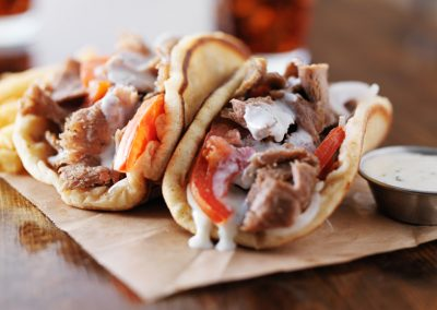greek gyros with tzatziki sauce and fries